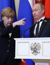 Не можем без Русия по някои въпроси, затова поддържам контакт с Владимир Путин, каза Ангела Меркел. Сн.: EPA/БГНЕС