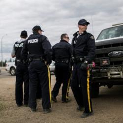 Канадски полицаи в действие. Сн.: EPA/БГНЕС
